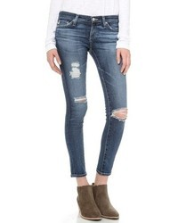 blaue enge Jeans mit Destroyed-Effekten von AG Jeans