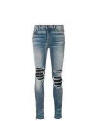 blaue enge Jeans mit Destroyed-Effekten von Amiri