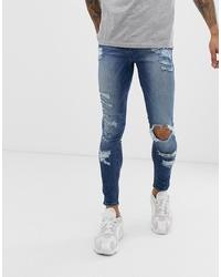 blaue enge Jeans mit Destroyed-Effekten von ASOS DESIGN