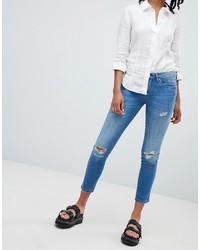 blaue enge Jeans mit Destroyed-Effekten von Blank NYC