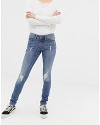 blaue enge Jeans mit Destroyed-Effekten von Blend She