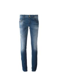 blaue enge Jeans mit Destroyed-Effekten von Diesel