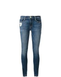 blaue enge Jeans mit Destroyed-Effekten von Frame Denim