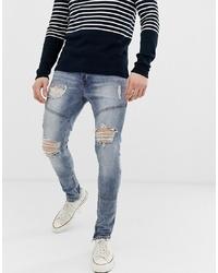 blaue enge Jeans mit Destroyed-Effekten von Hermano