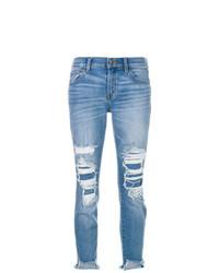 blaue enge Jeans mit Destroyed-Effekten von J Brand
