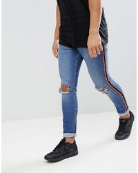 blaue enge Jeans mit Destroyed-Effekten von Jaded London