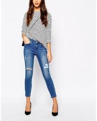 blaue enge Jeans mit Destroyed-Effekten von Oasis