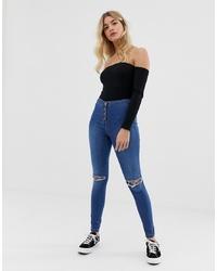 blaue enge Jeans mit Destroyed-Effekten von Parisian