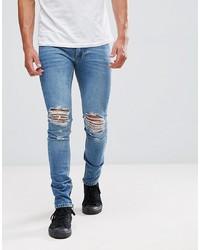 blaue enge Jeans mit Destroyed-Effekten von Religion