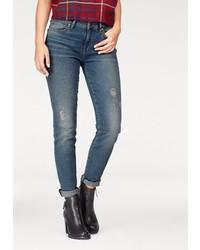 blaue enge Jeans mit Destroyed-Effekten von Tommy Hilfiger