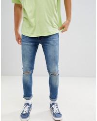 blaue enge Jeans mit Destroyed-Effekten von YOURTURN