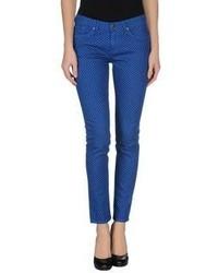 Blaue gepunktete Enge Jeans