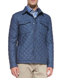 blaue Jacke mit einer Kentkragen und Knöpfen