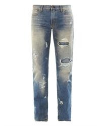 blaue Jeans mit Destroyed-Effekten