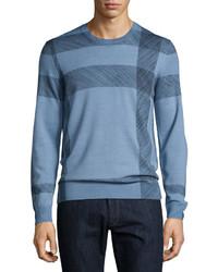 blauer Pullover mit einem Rundhalsausschnitt mit Karomuster