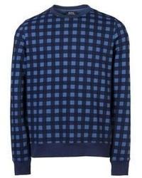 blauer Pullover mit einem Rundhalsausschnitt mit Schottenmuster