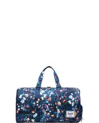 dunkelblaue bedruckte Segeltuch Reisetasche von Herschel