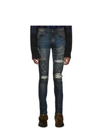dunkelblaue enge Jeans mit Destroyed-Effekten von Amiri