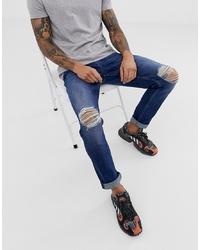 dunkelblaue enge Jeans mit Destroyed-Effekten von ASOS DESIGN