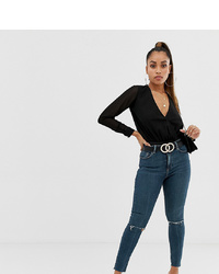 dunkelblaue enge Jeans mit Destroyed-Effekten von Asos Petite