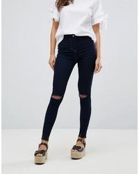 dunkelblaue enge Jeans mit Destroyed-Effekten
