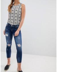 dunkelblaue enge Jeans mit Destroyed-Effekten von Glamorous