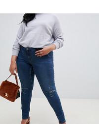 dunkelblaue enge Jeans mit Destroyed-Effekten von Junarose