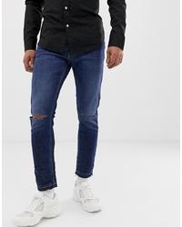 dunkelblaue enge Jeans mit Destroyed-Effekten von Love Moschino