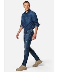 dunkelblaue enge Jeans mit Destroyed-Effekten von Mavi