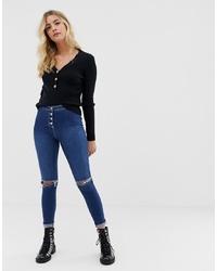 dunkelblaue enge Jeans mit Destroyed-Effekten von Parisian