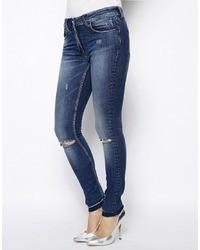 dunkelblaue enge Jeans mit Destroyed-Effekten von Religion