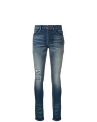 dunkelblaue enge Jeans mit Destroyed-Effekten von Saint Laurent