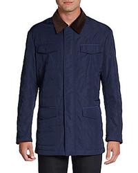 dunkelblaue gesteppte Jacke mit einer Kentkragen und Knöpfen
