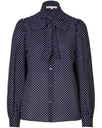 dunkelblaue und weiße gepunktete Bluse mit Knöpfen