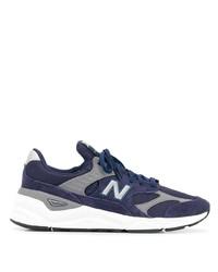 dunkelblaue und weiße Sportschuhe von New Balance