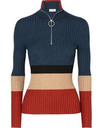 dunkelblauer Pullover mit einem Reißverschluss am Kragen von Marni