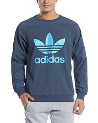 dunkelblauer Pullover mit einem Rundhalsausschnitt von adidas