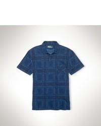 dunkelblaues Polohemd mit Schottenmuster