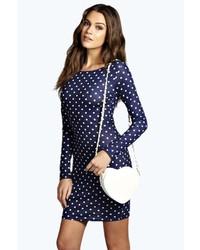 dunkelblaues und weißes gepunktetes figurbetontes Kleid