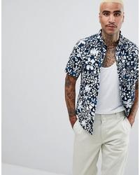 dunkelblaues und weißes Kurzarmhemd mit Blumenmuster von Vans