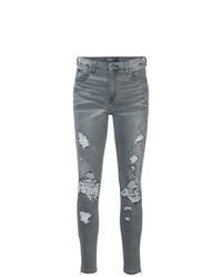 dunkelgraue enge Jeans mit Destroyed-Effekten von Amiri