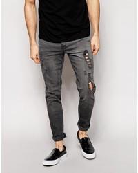 dunkelgraue enge Jeans mit Destroyed-Effekten von Asos