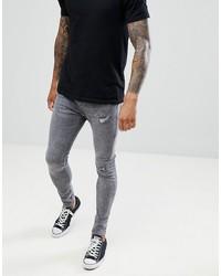 dunkelgraue enge Jeans mit Destroyed-Effekten von Bershka