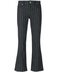 dunkelgraue vertikal gestreifte Schlagjeans von Versace