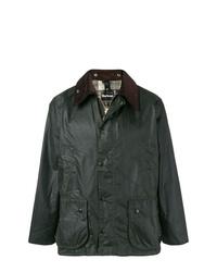 dunkelgrüne Jacke mit einer Kentkragen und Knöpfen