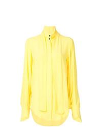 Gelbe Bluse mit Knöpfen
