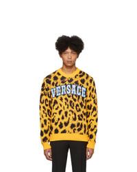 gelber bedruckter Pullover mit einem Rundhalsausschnitt von Versace