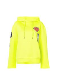 gelbgrüner Pullover mit einer Kapuze