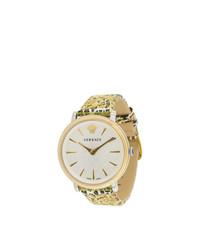 goldene bedruckte Uhr von Versace