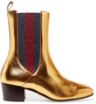 3a612b96467330 ... goldene Chelsea-Stiefel aus Leder von Gucci ...